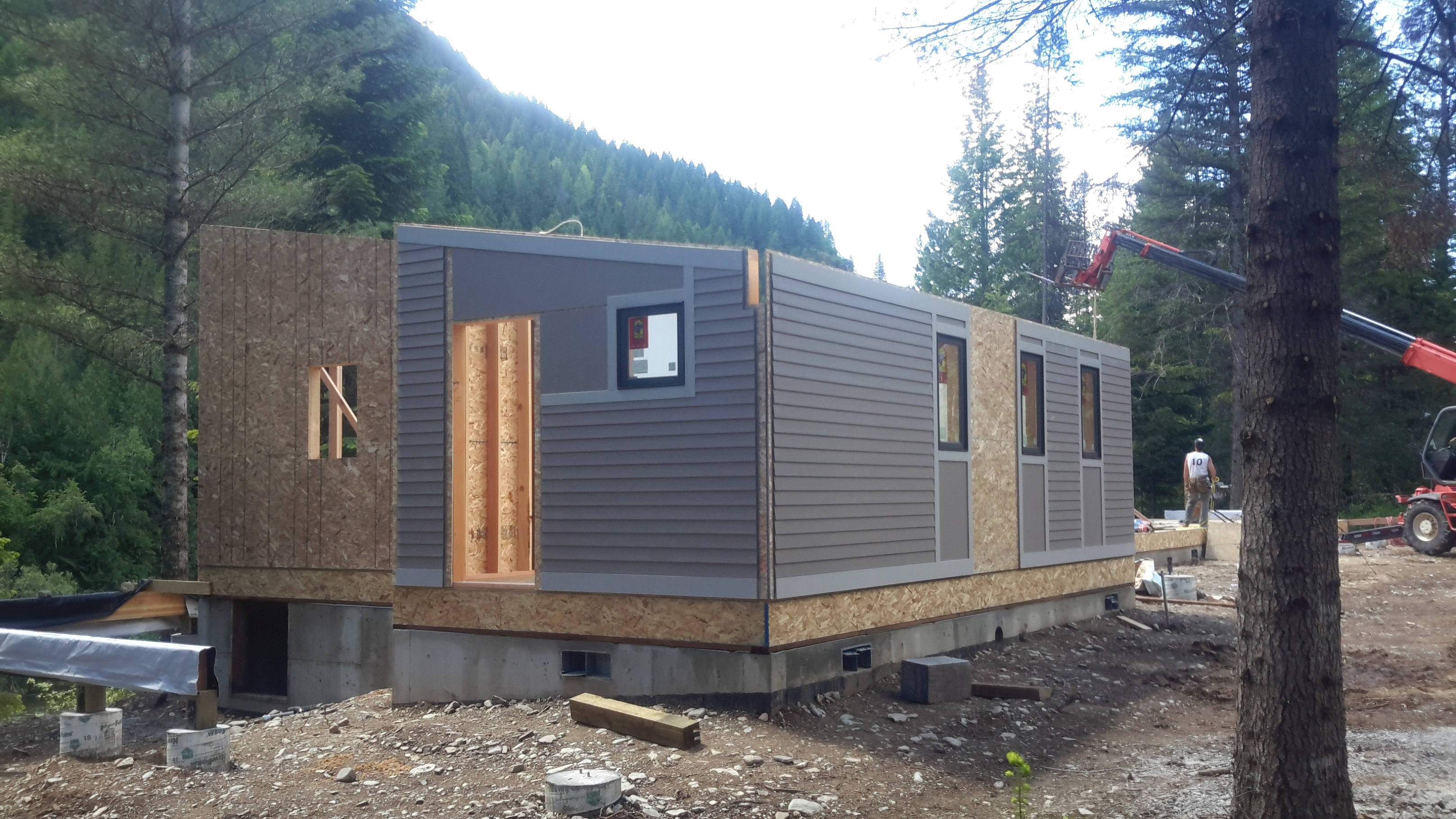 Setting panelized walls with me homes for Panelized cabins